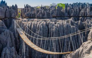 Rope bridge across stony cliffs